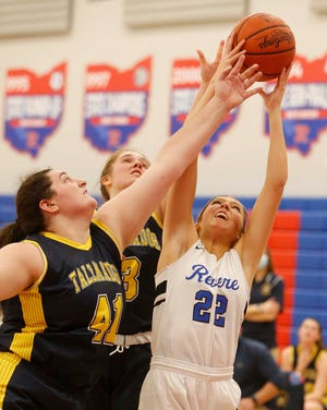 Adison Novosel, right, of Revere grabs the rebound over Addie Bowman, left, and Maya Dexter of Tallmadge during the first half of their game Monday, Jan. 11, 2021 in Richfield, Ohio.