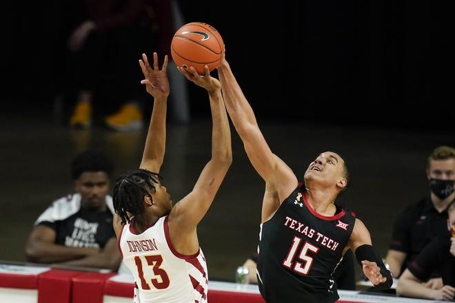 Texas Tech guard Kevin McCullar (15) blocks a shot by Iowa State forward Javan Johnson (13) during the second half of an NCAA college basketball game, Saturday, Jan. 9, 2021, in Ames, Iowa. Texas Tech won 91-64. (AP Photo/Charlie Neibergall)