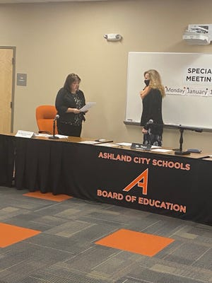 Interim treasurer Sheryl Shaw-Stewart swears in Gina Deppert as a new member of the Ashland City Schools Board of Education during Monday's school board meeting.