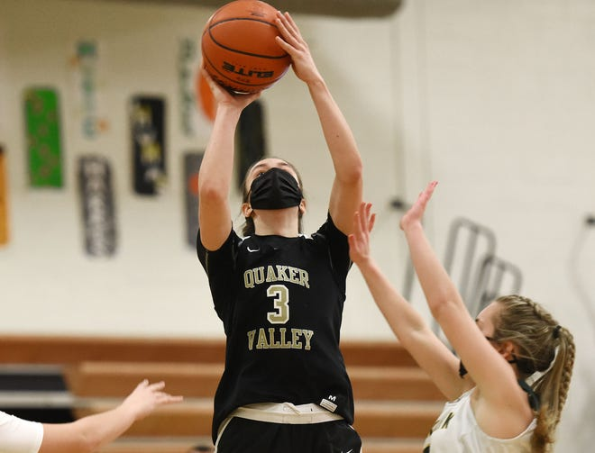 Quaker Valley's Bailey Garbee shoots over Blackhawk's Kassie Potts during Monday night's game at Blackhawk High School.