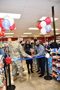 Cutting the ribbon at the Express 3 reopening Jan. 6 are, from left to right, Brig. Gen. David S. Doyle, Joint Readiness Training Center and Fort Polk commanding general, Command Sgt. Maj. Michael C. Henry, post command sergeant major, Ruth Shepherd, Express 3 store manager, Col. Ryan K. Roseberry, garrison commander, Antonio M. Porter Sr., AAFES mid-central region vice president, and Ronald McDuffie, Fort Polk Exchange general manager.