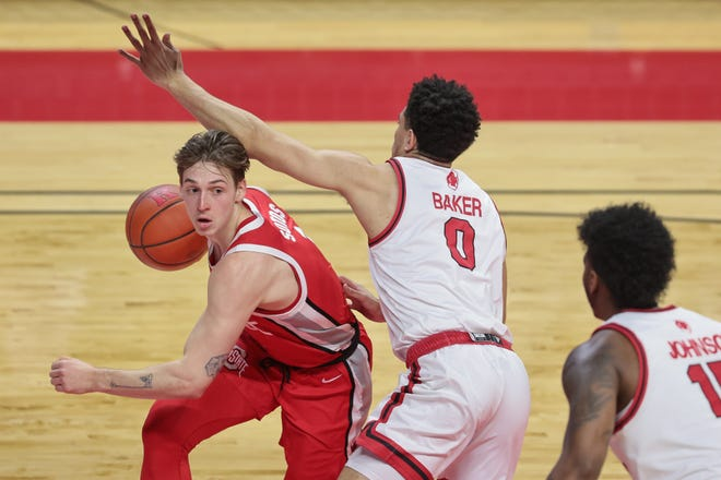 Ohio State guard Jimmy Sotos, left, played a season-high 28 minutes in a win over Rutgers on Saturday before departing in the final minutes with an apparent shoulder injury.