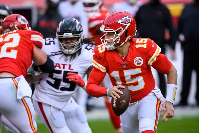 Kansas City Chiefs quarterback Patrick Mahomes (15) is chased by Atlanta Falcons defensive end Steven Means (55) during a game Dec. 27 in Kansas City.