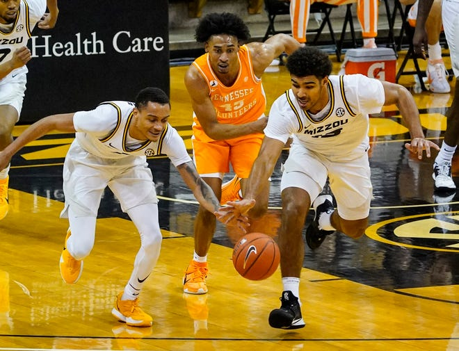Missouri guards Xavier Pinson (1) and Mark Smith (13) chase down a loose ball against Tennessee guard Keon Johnson (45) during a game Dec. 30 at Mizzou Arena.