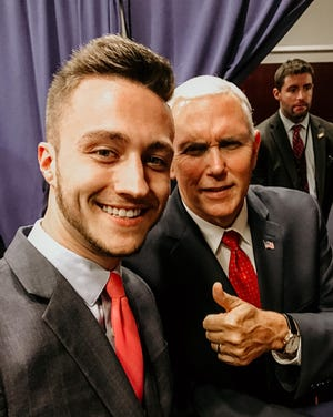 In this 2017 photo, Marysville City Councilman Aaron Carpenter takes a selfie with Vice President Mike Pence at a campaign fundraising event in Columbus.