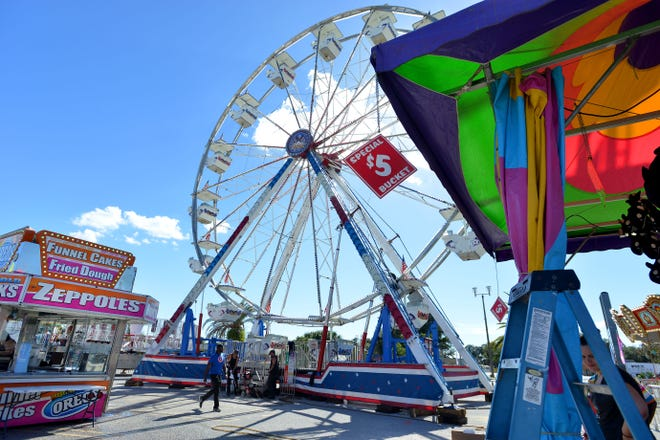 Dreamland Amusements sets up the Lake Square Mall Carnival in front of the shopping center on Thursday, Jan. 12, 2017. [Daily Commercial File]