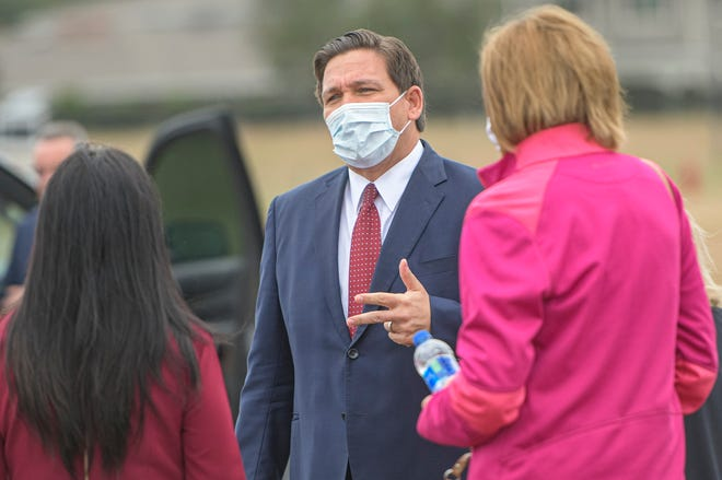 Gov. Ron DeSantis speaks with local officials at a COVID-19 vaccination site in The Villages on Tuesday, Jan. 12, 2021. [PAUL RYAN / CORRESPONDENT]