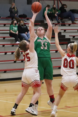Barnesville's Anna Yater (33) gets off a shot over St. Clairsville's Madison Sadler (25) and Alexis Thoburn (00) during Monday night's game in St. Clairsville