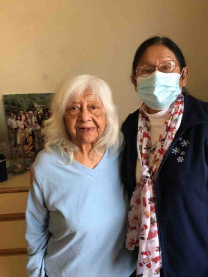 Betty Martinez, SunPorch of Dodge City elder, interacts with her daughter, Esther Bos. SunPorch began allowing limited visitation for its residents.