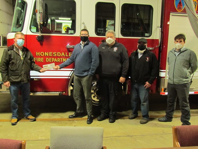 The Honesdale Lions Club donated $5,000 to help Honesdale Volunteer Fire Department purchase equipment for their rescue engine. Pictured left to right: Bill O'Neill, Scott Floyd, Steve Bates, Dan Card and Brian Dulay.