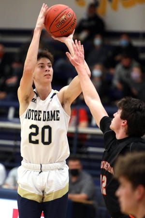 Notre Dame High School's Josh Smith (20) shoots the ball during their game against Washington High School, Monday Jan. 11, 2021 at Notre Dame's Father Minett Gymnasium.