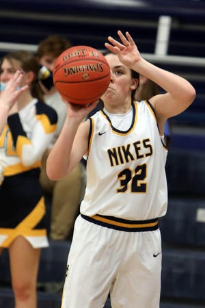 Notre Dame High School's Shelby Bowman (32) puts up a shot during their game against Washington High School, Monday Jan. 11, 2021 at Notre Dame's Father Minett Gymnasium.