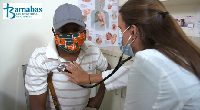 Lead Physician Assistant Jessie Hiott checks out a patient at Barnabas, a Nassau County nonprofit that provides health services, food and crisis assistance, among other programs. The center was one of 117 to receive a grant from The Community Foundation for Northeast Florida's pandemic-related Respond/Adapt/Recover Fund.