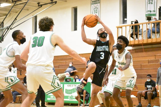 Forestview's Tra Neely rises for a lay-up during the second half of Monday's matchup at Ashbrook. [JOE HUGHES/Gaston Gazette]