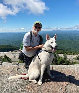Peter Travisano and Brady are shown during their hike on Mount Cardigan in New Hampshire.