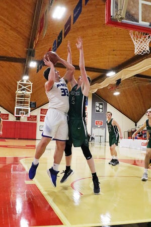 Murdock center Cam Monette (33), shown taking a shot from the low block during the Blue Devils' Clark Tournament victory over Parker School last year, is the Blue Devils' top returning scorer and a team captain this year.