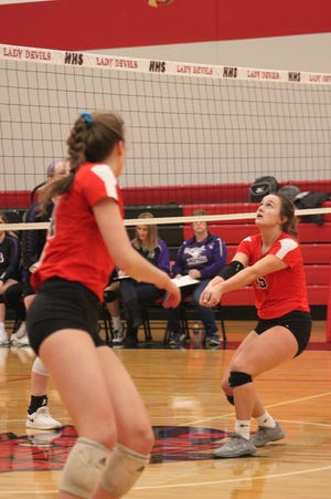 Charger Ashley Awbrey, right, sets the ball during the sectional championship match on Nov. 6, 2019, at Spring Valley Hall. Orion won and advanced to the super-sectional match, where they fell to the eventual state champion, Decatur St. Teresa. Mackenzie Grafton is on the left
