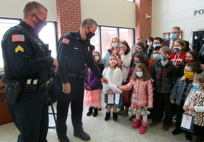 Cora Senkbeil was among the children in the Sunday school classes at First Baptist Church in Geneseo to visit the Geneseo Police Station on Sunday, Jan. 10, to present a drawing to Police Chief Casey Disterhoft, with Police Sgt. Jamison Weisser looking on.