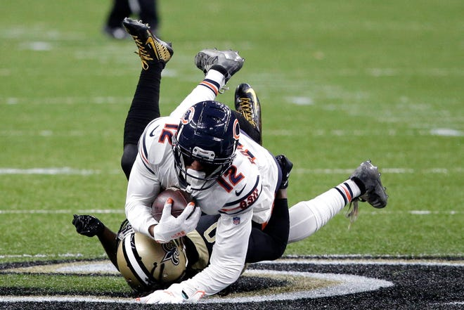 Chicago Bears wide receiver Allen Robinson (12) is tackled by New Orleans Saints cornerback Janoris Jenkins in the second half of Sunday's wild-card playoff football game in New Orleans.