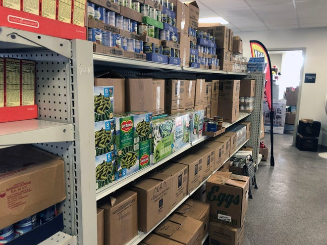 Stores of food await unpacking at Grand Central Station's new location Saturday as the soup kitchen's moving process began with a volunteer work day.