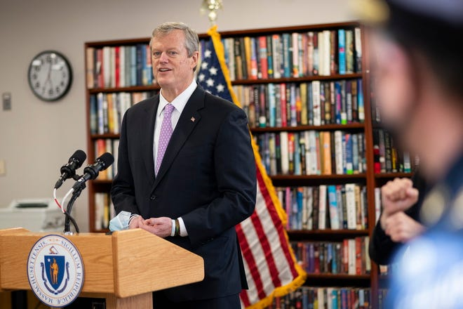 Gov. Charlie Baker provides a COVID-19 update while touring the first responder vaccination site at the Worcester Senior Center on Tuesday, January 12, 2021.