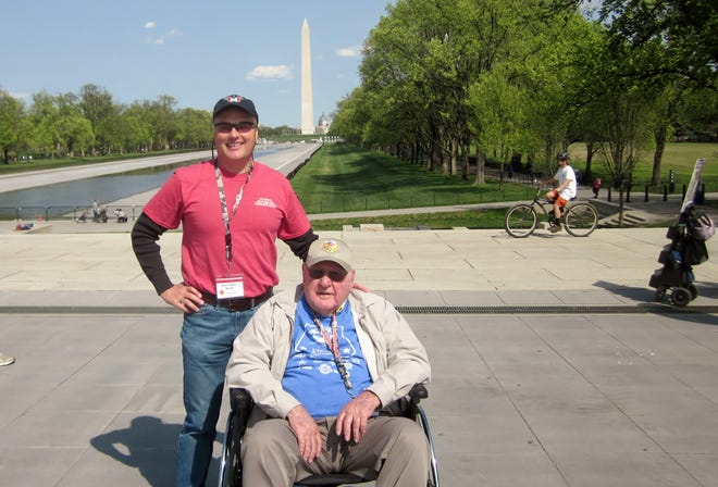 Fletcher's Brett Miller, left, poses with a veteran at the Washington Monument.