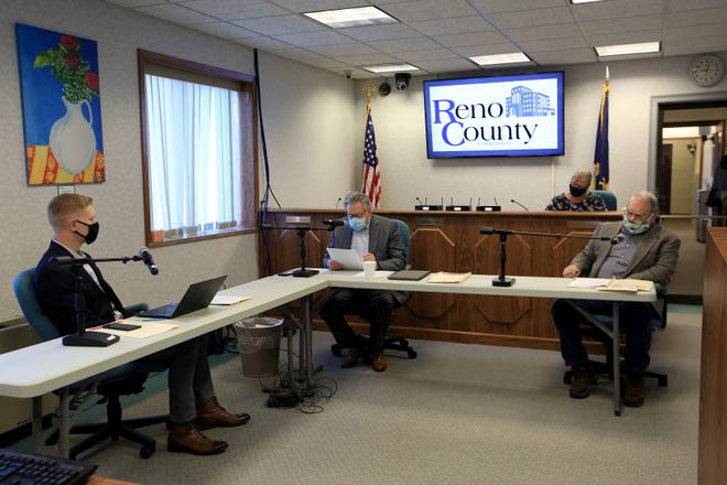 Reno County Commissioners Daniel Friesen, left, Ron Sellers and Ron Hirst begin the commission meeting Tuesday morning, Jan. 12, 2021.