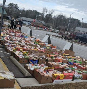 Onslow Community Outreach recently distributed thousands of pounds of food during its monthly food bank event. For those in need, the next event will be on Feb. 8 held at Onslow Community Outreach Support Center, 1211 Hargett Street, Jacksonville.