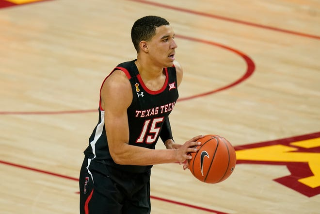 Texas Tech guard Kevin McCullar drives up court during the first half of an NCAA college basketball game against Iowa State, Saturday, Jan. 9, 2021, in Ames, Iowa. (AP Photo/Charlie Neibergall)