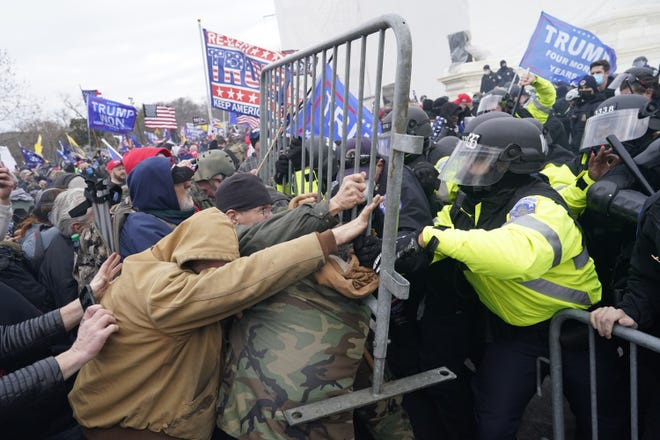 Donald Trump supporters attempt to force their way through a police barricade in front of the U.S. Capital on Wednesday, Jan. 6, 2021, in Washington, D.C. (Kent Nishimura/Los Angeles Times/TNS)
