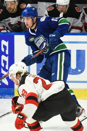 Utica's Kole Lind. shown during a game in January, is among the players assigned to the Comets on Tuesday. He was sixth on the team in 2019-20 with 44 points.
