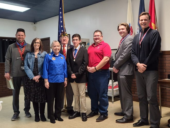 Left to right: Elementary School Teacher of the Year Award winner David McElveen, Anthony Elementary; High School Teacher of the Year Jennifer Moore, West Port; Barbara Anderson, District 22 VFW Auxiliary president; Robert Bray, District 22 VFW commander; Matias Colen, 1st Place Patriots Pen;  Middle School Teacher of the Year Award winner Joshua DuPre, Lake Weir Middle;  Samuel Peterson 1st Place Voice of Democracy; and Caleb Ian King, 3rd Place winner, King Voice of Democracy.