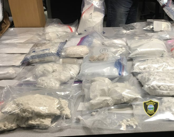 Quincy police seized 18 kilograms of cocaine and fentanyl, $384,000 in cash and five pistols following five raids on Jan. 11, 2021.