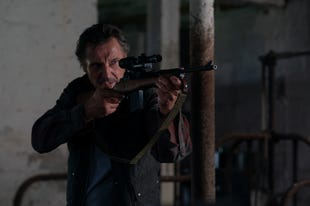 Liam Neeson protects a young boy in 'The Marksman'
