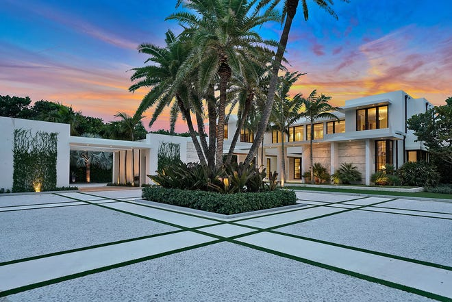 Listed a month ago with a record-setting $140 million price tag, a beachfront mansion at 535 N. County Road in Palm Beach is under contract, according to the local multiple listing service. The motor court of the contemporary-style house developed on speculation is anchored by a planting of palm trees.