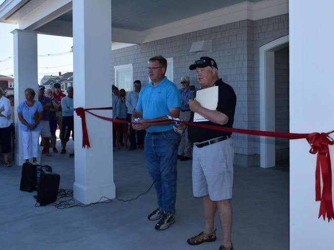 York Bathhouse Building Committee Chairman Jim Bartlett, right, cuts a ribbon with York Board of Selectmen Chair Todd Frederick to officially celebrate the opening of the Long Sands Bathhouse July 9, 2018.