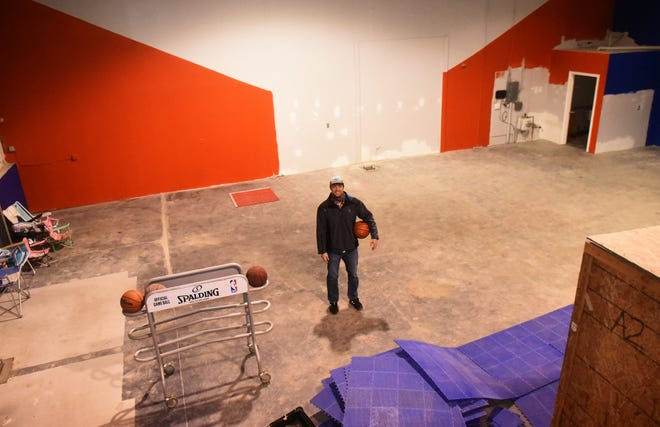 Corey Hassan, who led the Merrimack High School boys basketball team to two state championships, stands in his new facility called Seacoast Hoops Lab on Banfield Road in Portsmouth. The facility, which plans to be open on February 1, will offer personalized fundamental basketball training in small groups.