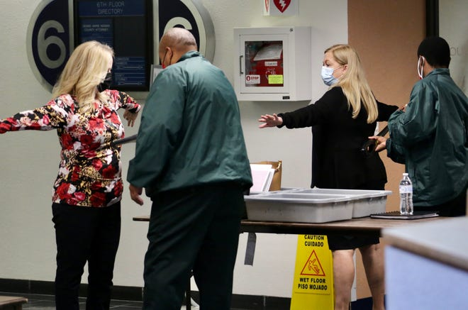 People undergo a second screening before entering the Palm Beach County Commission chambers Tuesday.