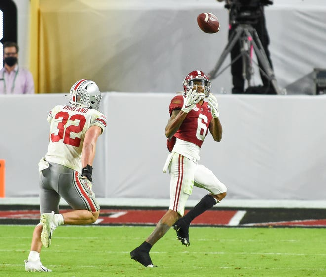 Alabama wide receiver DeVonta Smith (6) catches a third quarter touchdown at the College Football Playoff Championship Game at Hard Rock Stadium in Miami Gardens, Jan. 11, 2021.  Smith scored three touchdowns on the evening as the Crimson Tide defeated the Buckeyes 52-24.