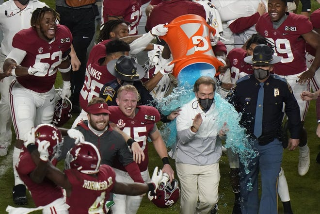 Alabama head coach Nick Saban is soaked in a sports drink after the Crimson Tide's win over Ohio State in the College Football Playoff national championship game Monday in Miami Gardens. Alabama won 52-24. (AP Photo/Wilfredo Lee)