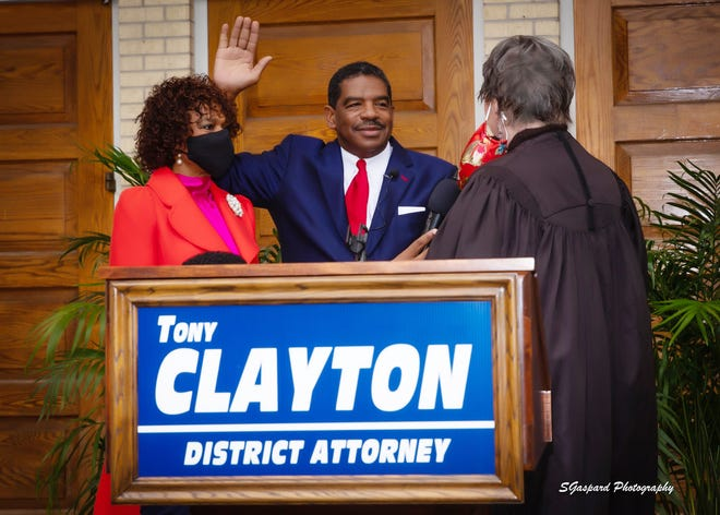 District Attorney Tony Clayton takes the oath of office, as his wife, Paula, holds the Bible. He was sworn in by retired Louisiana Supreme Court Judge Kitty Kimball.