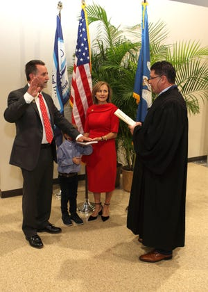 Plaquemine Mayor Ed Reeves takes the oath of office.