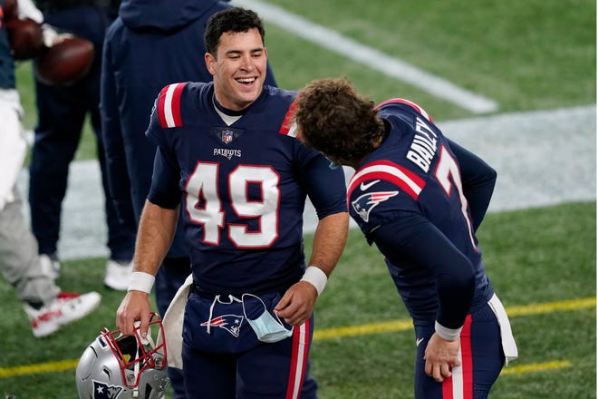 New England Patriots long snapper Joe Cardona, left, speaks with punter Jake Bailey on the sideline of the Dec. 28 game against the Bills.