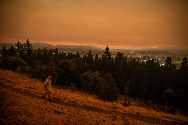 Smoke from the Beachie Creek Fire degraded air quality across Lane County in September. Horst Lueck, 70, walks along Skinner Butte in the smoky morning air.