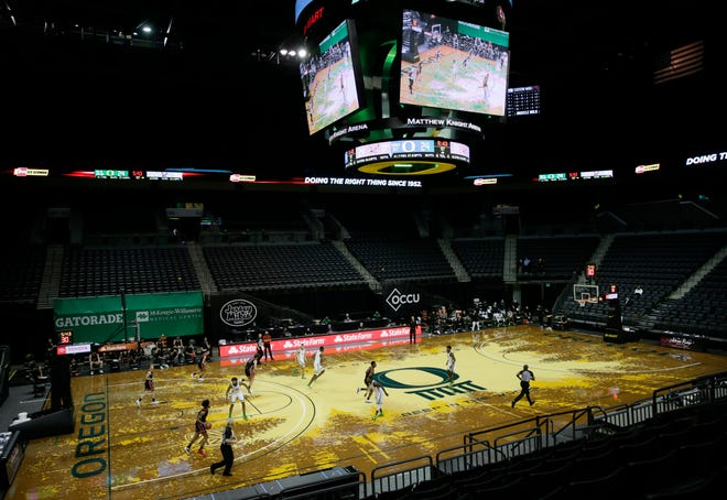 The Oregon mens basketball team plays a game with no crowd as part of COVID protocols. UO is considering a proposal where students who want to attend games at the discounted student rate will have to buy a pass.