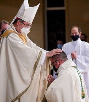 The Laying of Hands by Most Rev. Christophe Pierre during Tuesday's ordination Mass for Rev. David J. Bonnar.