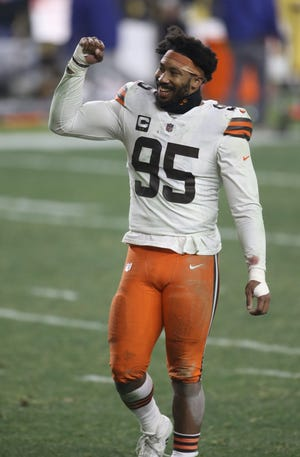 Browns defensive end Myles Garrett (95) reacts after the AFC Wild Card win over the Steelers, Jan. 10, 2021, in Pittsburgh. [Charles LeClaire/USA TODAY Sports]