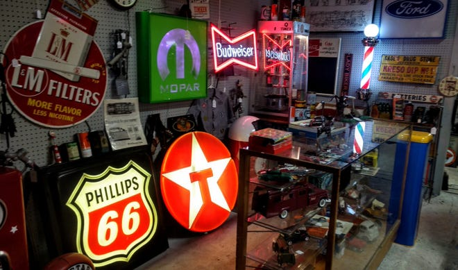 An array of vintage signs at the Rustic Birdcage in Columbiana.