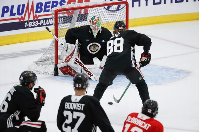 Former Rockford IceHogs goaltender Collin Delia defends against right wing Patrick Kane during a Blackhawks practice this past summer in Chicago. Delia is opening the season Wednesday night as the Hawks' No. 2 goalie behind Malcolm Subban.
