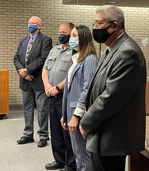 From left, Saline County Commissioner Roger Sparks, Sheriff Roger Soldan, Register of Deeds Rebecca Seeman and Treasurer Jim DuBois wait to be sworn in Monday. The Saline County officials who were elected to office on Nov. 3, 2020, were Soldan, Seeman, Sparks, DuBois, County Attorney Jeff Ebel, Commissioner Robert Vidricksen and Clerk Jamie Doss.